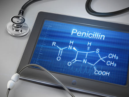 penicillin: penicillin word displayed on tablet with stethoscope over table
