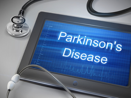 parkinson's disease: parkinsons disease words displayed on tablet with stethoscope over table