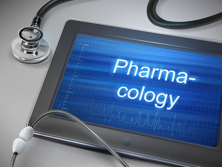 pharmacology word displayed on tablet with stethoscope over table