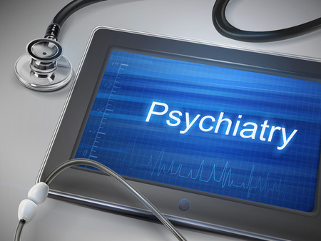 psychiatry: psychiatry word displayed on tablet with stethoscope over table