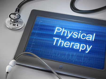 physical test: physical therapy words displayed on tablet with stethoscope over table