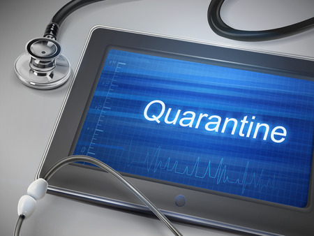quarantine: quarantine word displayed on tablet with stethoscope over table