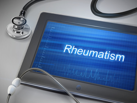 rheumatism: rheumatism word displayed on tablet with stethoscope over table