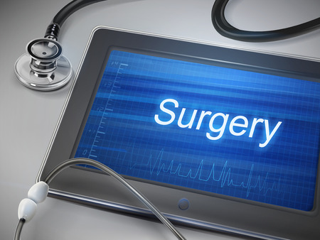 scalpel: surgery word displayed on tablet with stethoscope over table