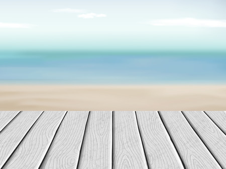 old pier: wooden floor with blurred beach and blue sky scenery