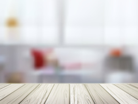 close-up look at wooden table over blurred kitchen scene