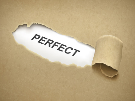 flawless: the word perfect behind brown torn paper