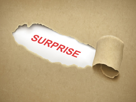 disbelief: the word surprise behind brown torn paper