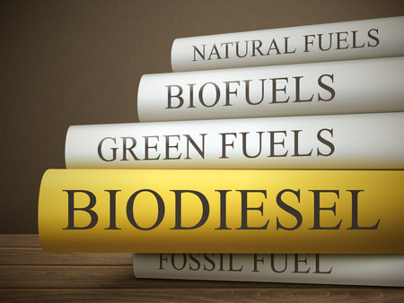 biomass: book title of biodiesel isolated on a wooden table over dark background Illustration