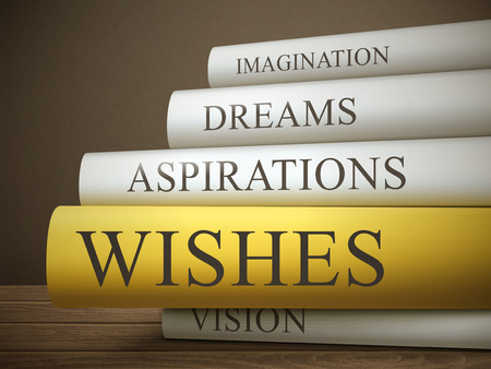 book reviews: book title of wishes isolated on a wooden table over dark background