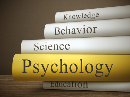 mental disorder: book title of psychology isolated on a wooden table over dark background