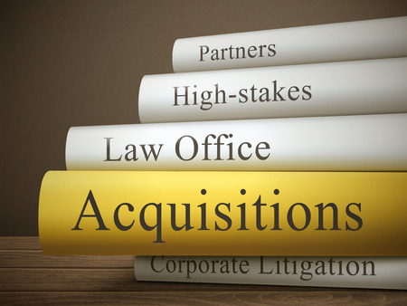 high stakes: book title of acquisitions isolated on a wooden table over dark background