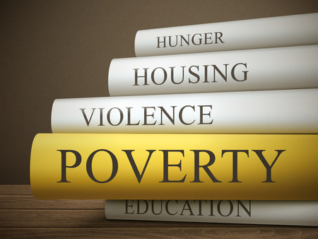 housing problems: book title of poverty isolated on a wooden table over dark background