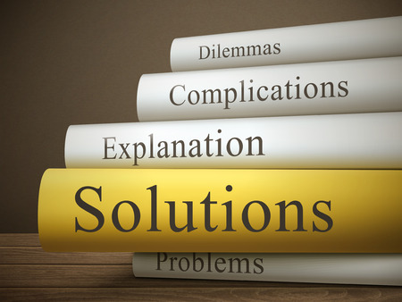 book reviews: book title of solutions isolated on a wooden table over dark background