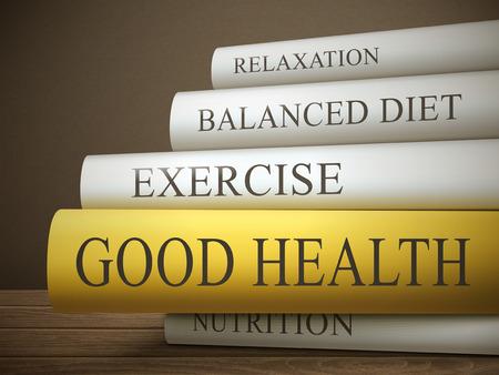 buena salud: t�tulo del libro de la buena salud aislado en una mesa de madera sobre fondo oscuro