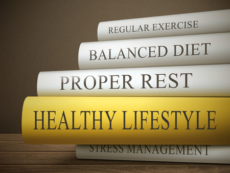 book reviews: book title of healthy lifestyle isolated on a wooden table over dark background