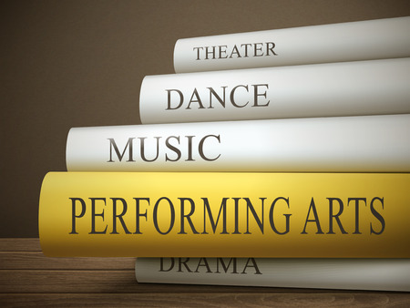 performing arts: book title of performing arts isolated on a wooden table over dark background