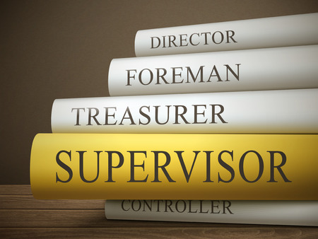 treasurer: book title of supervisor isolated on a wooden table over dark background