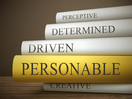 perceptive: book title of personable isolated on a wooden table over dark background