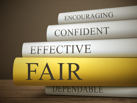 perceptive: book title of fair isolated on a wooden table over dark background
