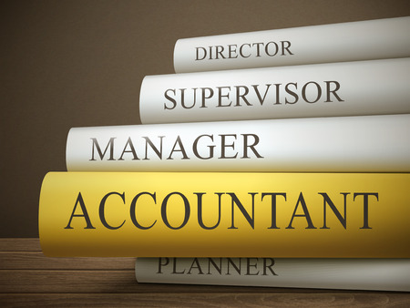 book title of accountant isolated on a wooden table over dark background