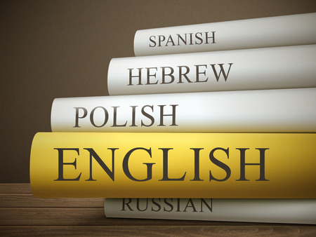 book title of english isolated on a wooden table over dark background