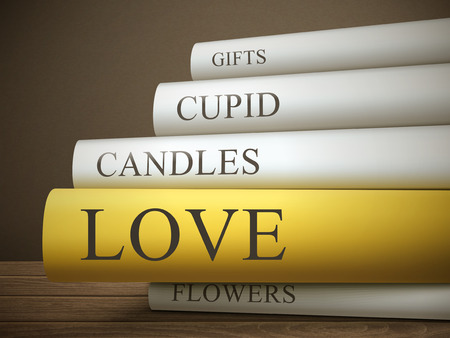 book reviews: book title of love isolated on a wooden table over dark background