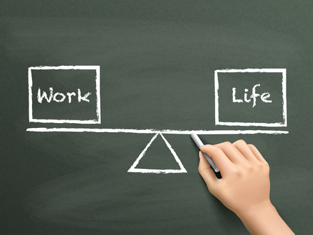 life balance: balance between work and life drawn by hand over chalkboard