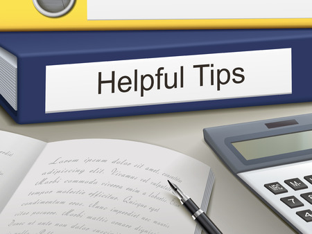 helpful: helpful tips binders isolated on the office table