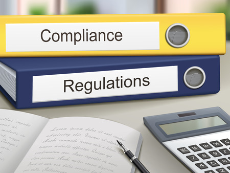 compliant: compliance and regulations binders isolated on the office table