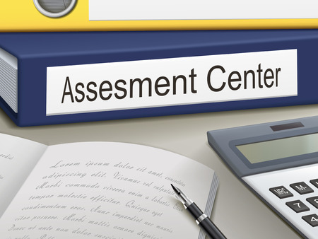 staffing: assessment center binders  isolated on the office table