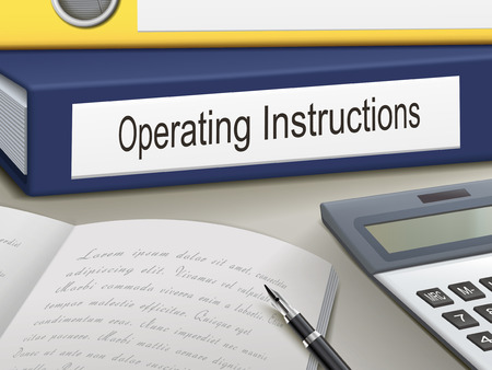 guidebook: operating instructions binders isolated on the office table