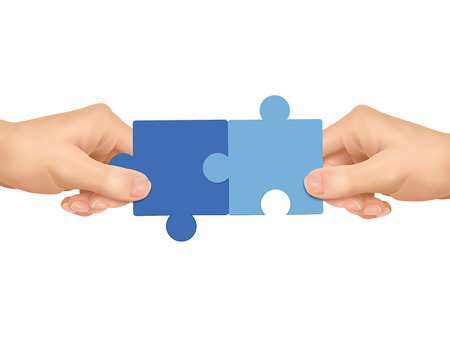 business growth: cooperation concept: hands holding jigsaw pieces over white background