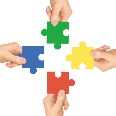 puzzling: cooperation concept: hands holding jigsaw pieces over white background