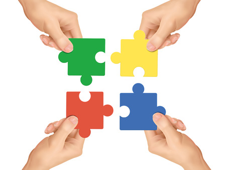 puzzle jigsaw: cooperation concept: hands holding jigsaw pieces over white background