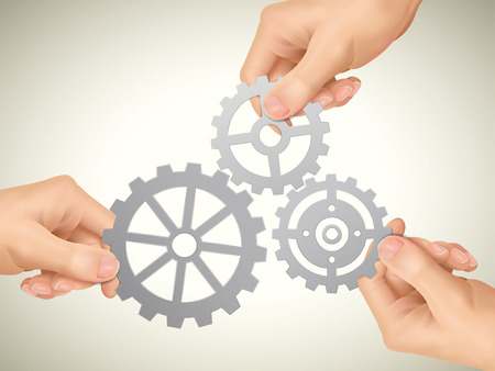 expose: cooperation concept: hands holding gears over beige background