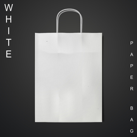 white paper bag: white paper bag isolated on black background