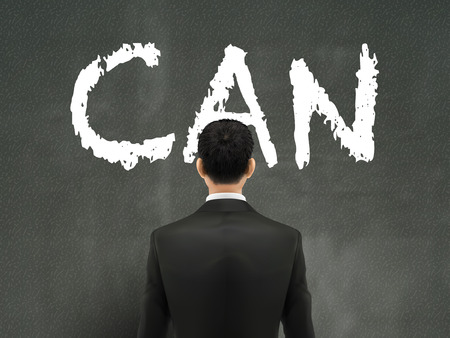 back problem: businessman looking at can word on wall Illustration