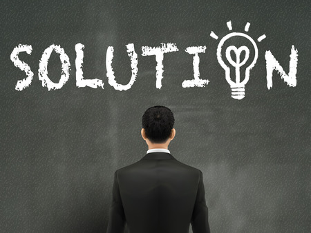 back problem: businessman looking at solution word on wall Illustration