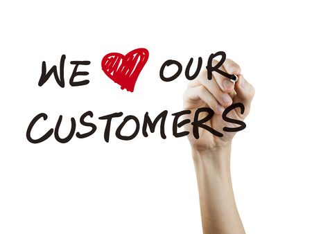 we love our customers words written by hand over white background Banque d'images