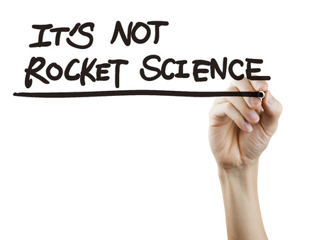it is not rocket science words written by hand over white background photo