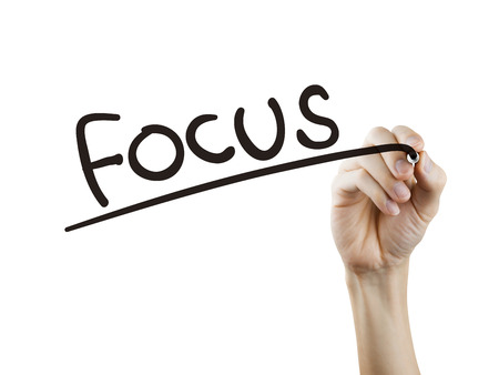 centralize: focus word written by hand over white background
