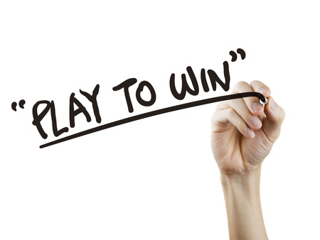 play to win words written by hand over white background