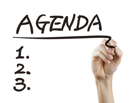 meeting agenda: agenda word written by hand over white background
