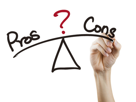 cons: balance between pros and cons written by hand over white background Stock Photo
