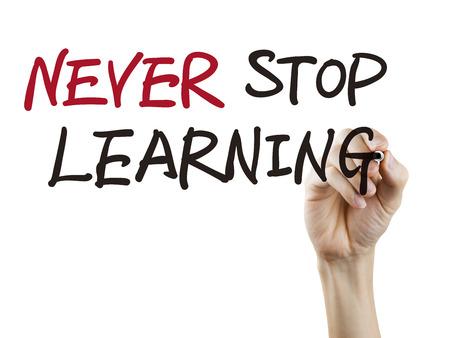 nunca: nunca dejar de palabras escritas a mano sobre fondo blanco aprendizaje Foto de archivo