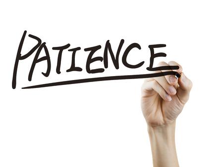paciencia: palabra paciencia escrito a mano en un tablero transparente Foto de archivo