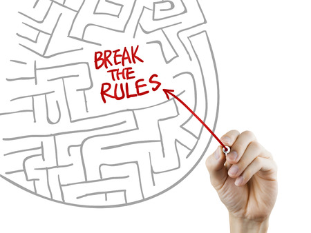 break the rules written by hand on a transparent board photo