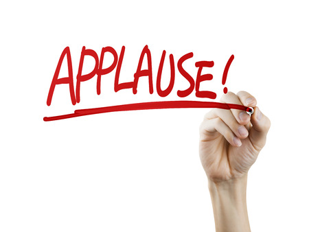 acclaim: applause word written by hand on a transparent board Stock Photo