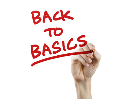 back to basics written by hand on a transparent board